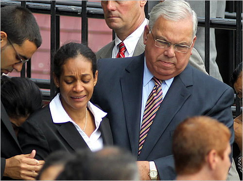 Dozens of mourners gathered at the Most Holy Redeemer Church in East Boston for the funeral of 58-year-old Richel Nova, the pizza delivery man killed last week in a Hyde Park robbery. In this photo, Boston Mayor Thomas Menino helped Marilin Pimentel, Nova's wife, to a limousine after the Mass was over. Read the article. Scroll through to see scenes from the church.
