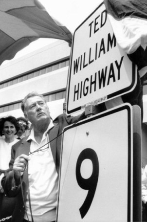 Ted Williams unveils a highway sign at a ceremony that dedicated a section of Route 9 to him in Natick on June 16, 1988. Williams, the Boston Red Sox's revered and sometimes reviled 'Splendid Splinter' and baseball's last .400 hitter, died in 2002.