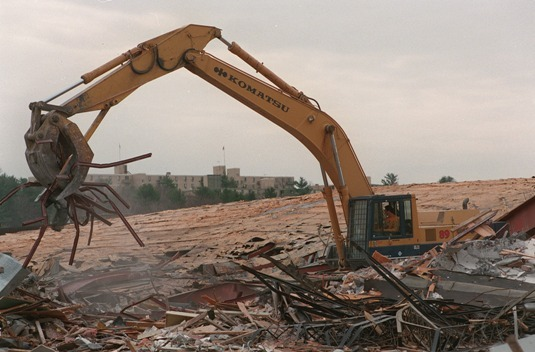 A machine clears wreckage from the Shoppers' World dome being torn down in 1994.