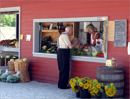 A customer loads up on produce at the Moses Farm stand in Eagle Bridge, N.Y.