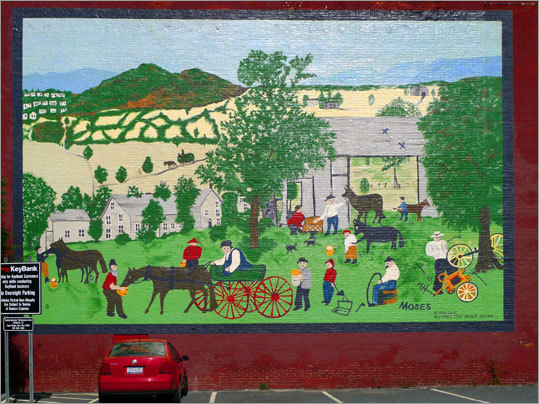 This mural of a Grandma Moses painting stands on Main Street near the intersection with John Street in Hoosick Falls, N.Y.