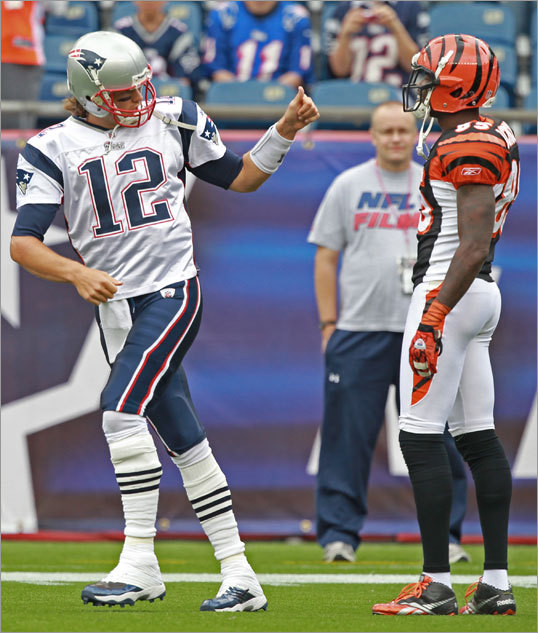 Patriots quarterback Tom Brady (left) gave a thumbs up to Bengals wideout Chad Ochocinco before the game.