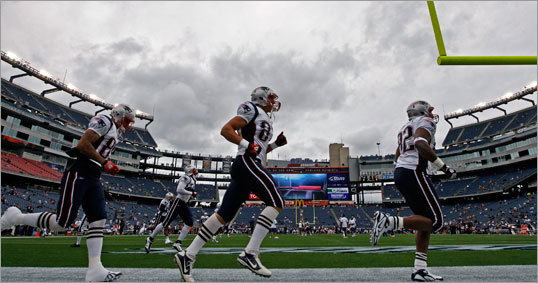 Patriots players took the field for the first game of the 2010 regular season.
