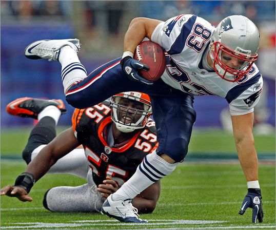 Patriots wide receiver Wes Welker left Bengals linebacker Keith Rivers in the dust as he fought for some more yardage after a catch