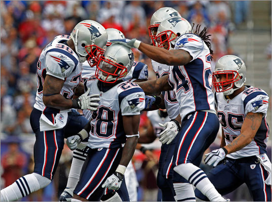 Patriots cornerback Darius Butler was mobbed by teammates including James Sanders (36,left). Jonathan Wilhite (24). and Patrick Chung (far right) after Butler made a big stop to deny the Bengals a first down.