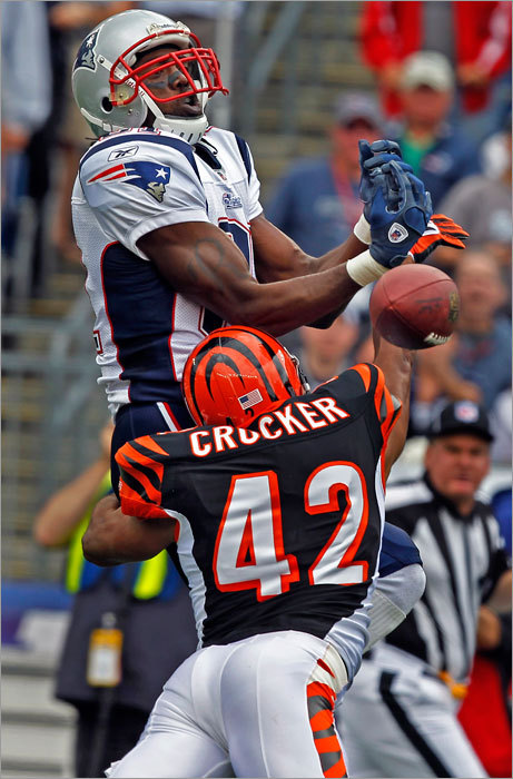 Randy Moss (left) had a pass slip out of his hands as he was defended by Chris Crocker.