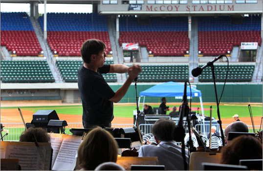 KEITH LOCKHART, Boston Pops conductor, rehearsing at McCoy Stadium in Pawtucket, R.I., Sept. 10, 2010 -- 'I was thinking what a great minor league ballpark this is for families. You know, if I could pull off a good Youkilis stance, I would, but I don't think anybody could possibly give that justice. This is during the 'National Game'' march, which John Philip Sousa wrote in the mid-1920s for the 50th anniversary of the National League. Which goes to show you how long baseball has been the national game. Instead of cymbal crashes, he substituted the crack of the bat. When we did the Red Sox record album last year, we actually went down to the batting cage and recorded Ortiz providing us with the crack of the bat. A conductor is closest to a player/coach position. Everybody says, 'You've got great players, what do you need a conductor for?' Well that's like saying, 'You've got great players on the Sox, what do you need a manager for?' You need somebody to figure out what the focus of the team is going to be. How the team is going to work in unison. Get the signals together and keep everyone going in the same direction.'