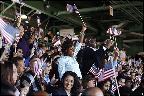 More than 5,100 people became US citizens at Fenway Park on Tuesday. US officials called it the largest naturalization ceremony in Massachusetts and one of the largest in America.