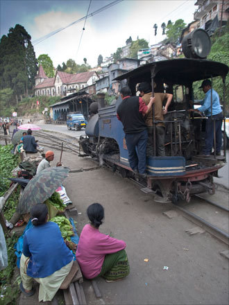 Riding on special, two-foot wide rails, the 'Toy Train' pulls into Darjeeling's station.