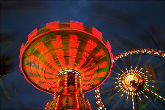 A chairoplane and a Ferris wheel lit up the night sky.