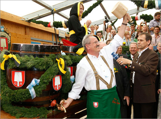 Munich's Mayor Christian Ude tapped the first barrel of beer with the traditional 'O´zapft is!' (It's tapped!) to start the Oktoberfest beer festival at the Theresienwiese.