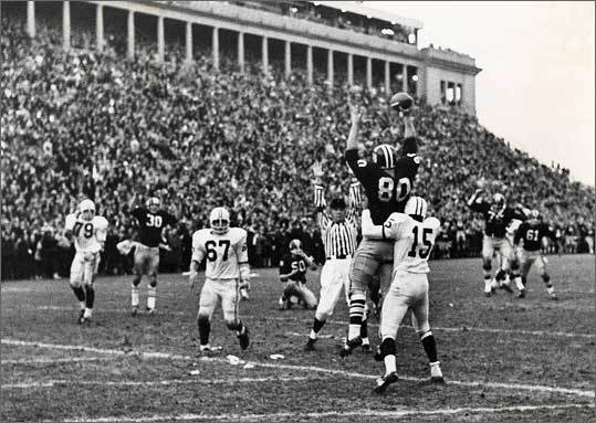 Harvard Beats Yale 29-29, 2008 This acclaimed documentary uses archival footage taken at Harvard Stadium during the famous 1968 football championship game. Pictured here is Harvard's Pete Varney, No. 80, catching quarterback's Frank Champis' two-point conversion pass in front of Yale's Ed Franklin, No. 15, to tie the football game 29-29 on Nov. 23, 1968.
