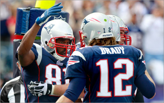 Randy Moss (left) celebrated with Tom Brady on the first of Moss's two touchdown receptions on the day.