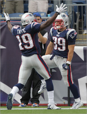 Patriots running back Danny Woodhead (right) celebrated with teammate Brandon Tate after Woodhead found the end zone in the second quarter.