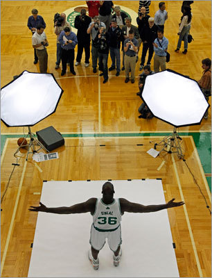 Media members wandered the Celtics' practice facility as Shaquille O'Neal (center) posed for official pictures.