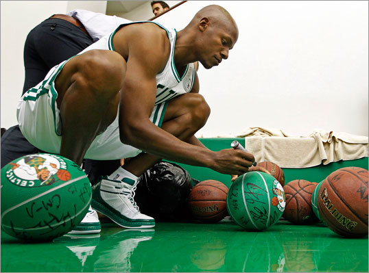 The Celtics held their annual media day Monday afternoon at the team's practice facility in Waltham. Players like Ray Allen posed for promotional photos, did television promos and interviews with reporters, and signed multitudes of autographs on photos and basketballs.