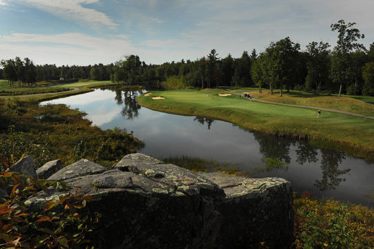 A ledge outcropping provides the foreground to the 8th hole at The Ledges Golf Club in York, Maine.