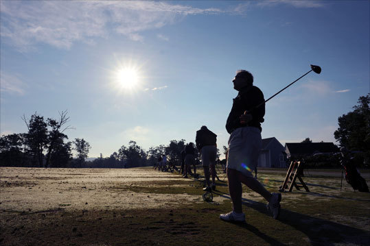 Tom Hammer of Newcastle, N.H.. was silhouetted by the early morning sun as he got in some practice before a tournament at The Ledges