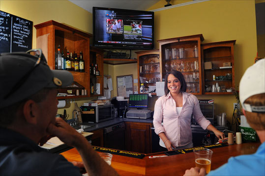 Bartender Jenn Falvey chats with folks at the bar at The Ledges Golf Club.