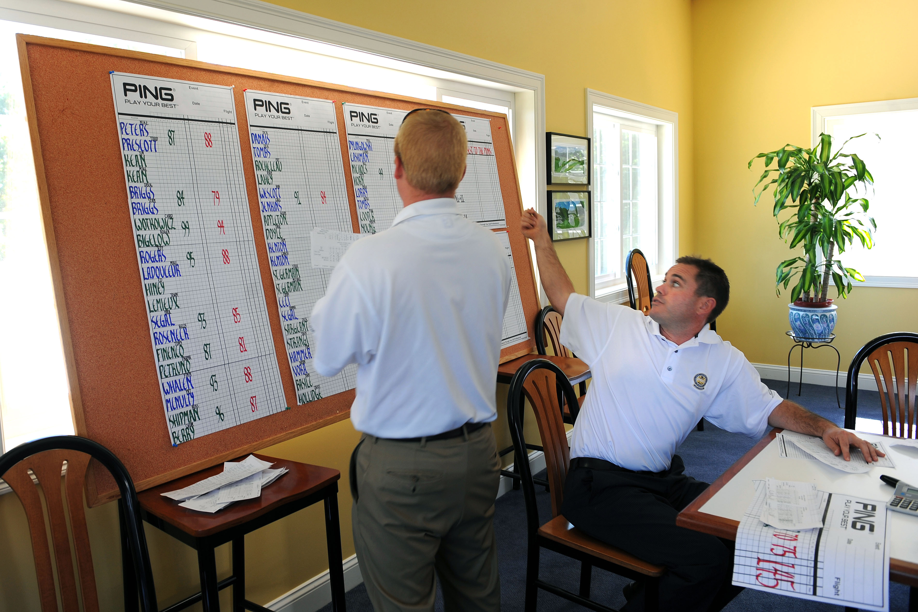 Golf Pro Matt Blasik, right, helped Dan Limauro post results of a tournament at the York, Maine, course.