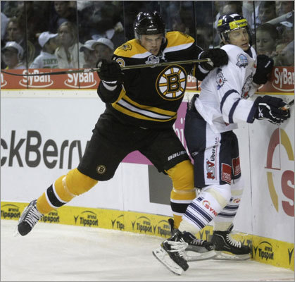 Bruins rookie Tyler Seguin (left) checks Martin Cakajik during the first period of their exhibition in Liberec, Czech Republic.