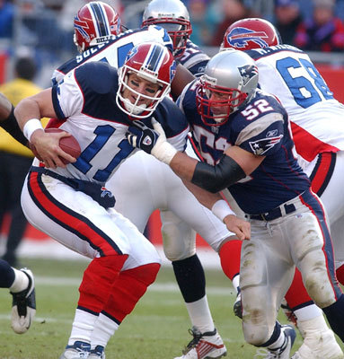 Drew Bledsoe A prodigy at Washington State, Bledsoe was a starter from Day 1 after the Patriots made him the first overall pick in the 1993 draft. The quarterback made the Pro Bowl four times and helped the Patriots to the playoffs on five occasions. But the last carried an asterisk, because after getting hurt in the third game of the 2001 season, Bledsoe watched first from a hospital bed, and then from the sideline as his replacement, unheralded Tom Brady, galvanized the Patriots and led them to the Super Bowl crown, their first of three in four years. Coach Bill Belichick's decision to stick with Brady rather than give an injured starter his job back was the source of much debate. Though he came off the bench in place of the injured Brady and guided the Patriots to an upset of the Steelers in the AFC Championship game, Bledsoe's nine-year New England reign effectively ended when the Jets' Mo Lewis rammed him on the sideline, causing severe internal injuries. The Patriots traded him to the Bills -- a division rival -- for a No. 1 pick after the 2001 season, which turned out to be Ty Warren.