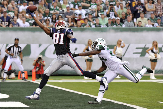 Of course, Moss's brilliance on the football field has been well-documented. This one-handed touchdown catch ahead of Jets star cornerback Darrelle Revis was his highlight moment so far in 2010. Moss has played 191 NFL games and caught 954 passes for 14,858 yards and 153 touchdowns.