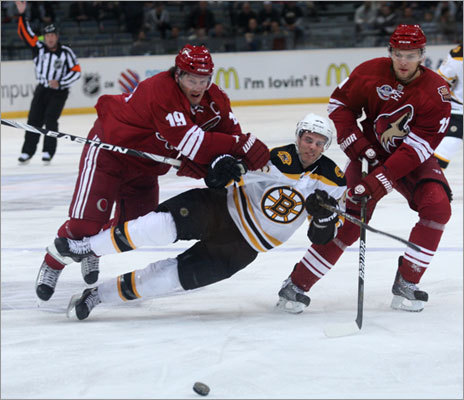 David Krejci (center) took a vicious hit, but the Bruins were the ones handing out most of the hits in a 3-0 win Sunday.