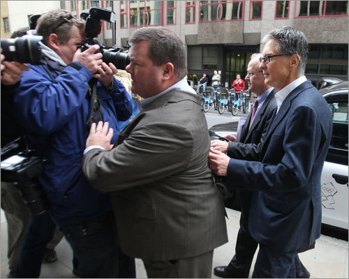 News photographers were eager to get a shot of Henry as he arrived at the London law offices to finalize the deal to buy Liverpool FC. Ed Weiss, the general counsel for the Red Sox and NESV, sets a block for him to slip into the building.