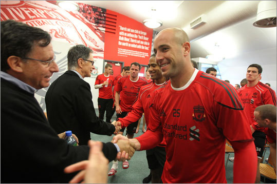 Liverpool goalie Pepe Reina greeted Liverpool Football Club chairman Tom Werner, who is part of the NESV ownership group, while principal owner John Henry greeted other players.
