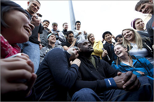 People took turns posing and sitting with Shaq next.