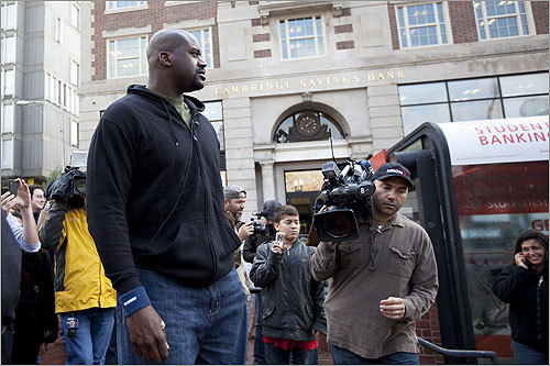Shaq looked for a place to sit in Harvard Square near the Red Line T stop. He had previously announced that he planned to pose as a statue and allow fans to photograph him.