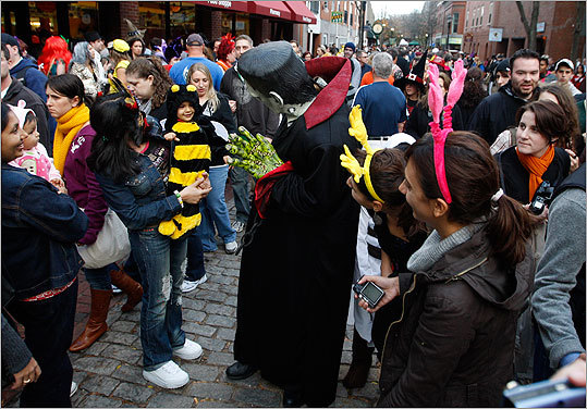 October 2009 David Kowalski of Peabody, dressed as Frankenstein, waved to Amisha Arora,1, and her mother, Meenakshi Arora of Malden (at left) during Halloween festivities on the Essex Street Mall.