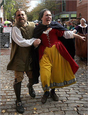 October 2009 Actor Daniel Parziale (left) hauled actress Natalie Miller down Essex Street on their way to a performance of 'Cry Innocent, The People versus Bridget Bishop.' It was one of the many performances during Salem's Haunted Happenings.