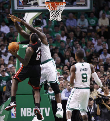 Miami's LeBron James was fouled by Shaquille O'Neal in the third quarter.