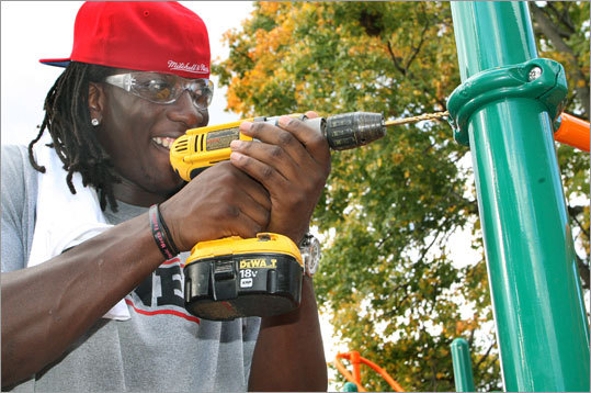 Patriots linebacker Gary Guyton helped put the finishing touches on the playground.