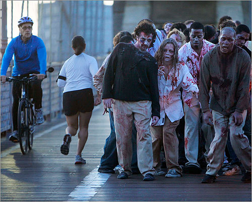Zombies also invaded New York City today, though it's not clear if anyone actually noticed. Pictured, zombies on the Brooklyn Bridge.