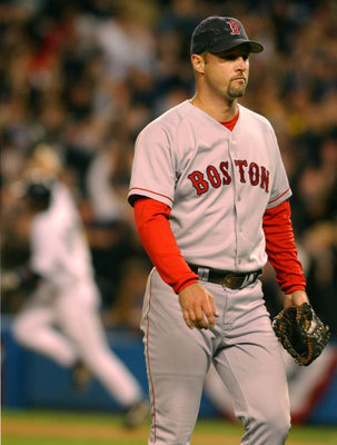 Wakefield walks from the field after giving up the winning home run to New York Yankees Aaron Boone in the 11th inning of Game 7 of the American League Championship Series in New York on Oct. 17, 2003. Wakefield won two games in the series before giving up the infamous home run to Boone that sent the Yankees to the World Series.