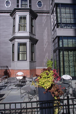 Guests can take the lounge offerings to the small outdoor patio beside the entrance or a third-floor terrace on the quiet side of the hotel opposite Massachusetts Avenue. There are five rooms with private balconies.