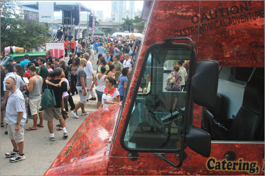 Rolling throughout South Florida, The Rolling Stove stops in downtown Miami for the Fall for the Arts festival at Adrienne Arsht Center. The Stove is famous for a sliced and fried baked potato dripping cheddar cheese known as Ron's Bites -- but they have gluttonous wings, burgers, and chocolate-covered frozen bananas with nuts, too.