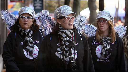 October 2010 From left to right, Mary Foster, Mindy Mercier, and Lindsey Cyr, all from Minot, Maine, walked the Essex Street Pedestrian Mall in Salem.
