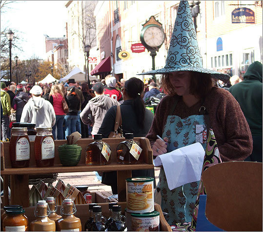 October 2010 Pamplemousse, a boutique on Essex Street in Salem, sold jellies, candles, and other goods on one of the city's busiest days of the year. At left, employee Amy Justo took inventory of the store's products.