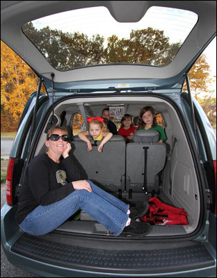 Kathy Hight of Shrewsbury and her four girls pose in the family's fifth minivan, a Town and Country tricked out with power sliding doors and an entertainment system. (Barry Chin / Globe Staff Photo)