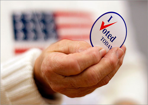 Republicans won back control of the US House of Representatives in midterm elections that many observers described as a referendum on President Obama. Read more Election Day coverage. A sticker was handed to a voter in Waterville, Maine.