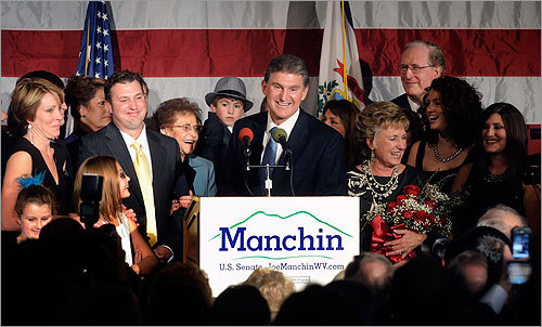 West Virginia Governor Joe Manchin, center, and his wife, Gayle, right, along with family and friends celebrated his win at a US Senate election party in Charleston, W.Va.