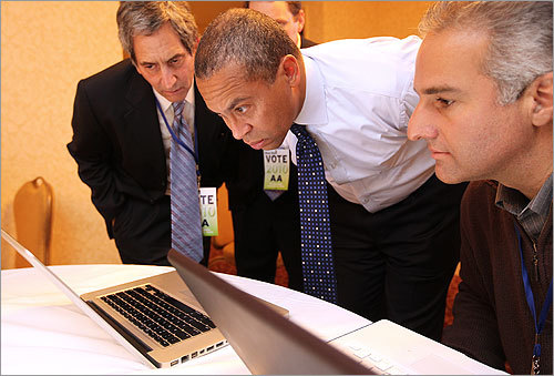 Governor Deval Patrick watched returns in the campaign's operations room at the Park Plaza Hotel. From left: campaign communications adviser Larry Carpman, Patrick, and campaign senior strategist Doug Rubin.