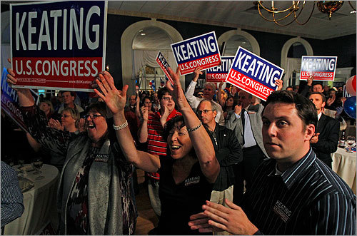 Supporters of Democrat William Keating cheered as they watched a television report showing their man leading over rival Jeff Perry.