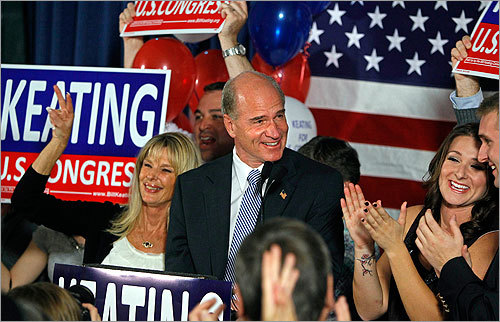 Democrat William Keating is welcomed by supporters following his victory over Jeff Perry in the 10th District. Keating was joined on stage with his wife, Tevis, left, and daughter Kristen, right. Read article.