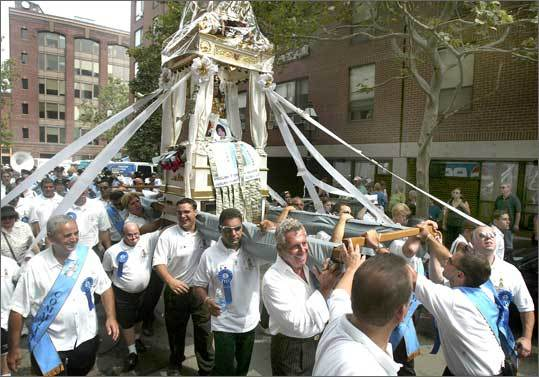 The statue of The Madonna is paraded through the streets on Aug. 21, 2005, as part of the Fisherman's Feast sponsored by the Madonna del Soccorso Society.