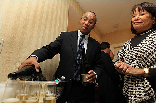 With wife Diane Patrick by his side, Patrick poured champagne.